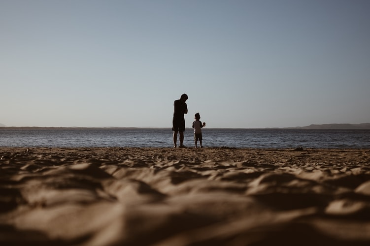 Father And Son On A Sea Shore